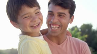 Portrait Of Hispanic Father And Son In Slow Motion