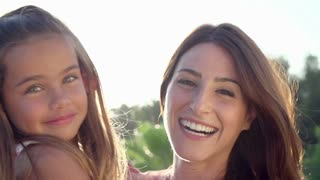 Portrait Of Hispanic Mother And Daughter In Slow Motion