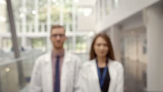 Portrait Of Male And Female Doctor In Hospital Reception