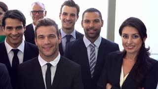 Portrait Of Multi-Cultural Office Staff Wearing Suits