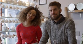 Portrait Of Young Couple Working In Coffee Shop Shot On R3D