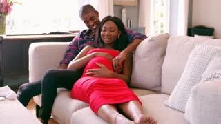 Pregnant Couple At Home Relaxing On Sofa Shot On R3D