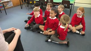 Pupils Copying Teacher's Actions Whilst Singing Song