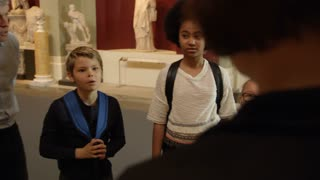 Pupils On School Field Trip To Museum With Guide Shot On R3D