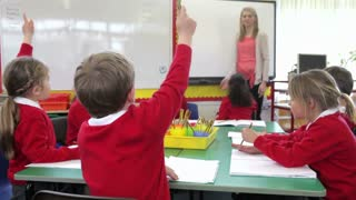 Pupils Sitting Around Table As Teacher Asks A Question