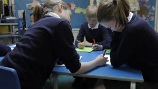 Pupils Working At Table Together