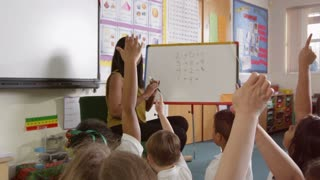 Pupils Writing Answer To Maths Problem On Board Shot On R3D