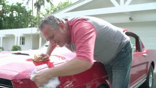 Retired Senior Man Cleaning Restored Car In Slow Motion