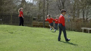 School Pupils Playing Chasing Game At Breaktime Shot On R3D