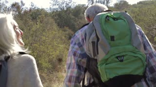 Senior Couple Hiking Along Country Path Together