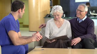 Senior Couple Meeting With Surgeon In Hospital