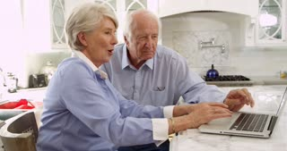Senior Couple On Laptop At Home Making Purchase Shot On R3D