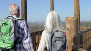 Senior Couple On Viewing Platform At The End Of Hike