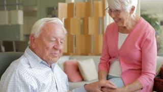 Senior Couple Reading Letter From Keepsake Box