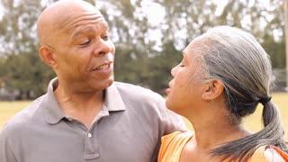 Senior Couple Taking Selfie In Park