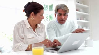 Senior Indian Couple Using Laptop Computer At Home