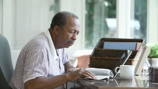 Senior Man Finding Phone Number Of Company Online