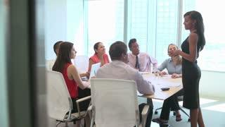 Seven Businesspeople Having Meeting Around Boardroom Table