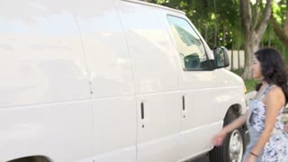Slow Motion Sequence Of Bakers Unloading Cake Boxes From Van