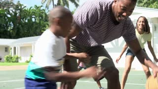 Slow Motion Sequence Of Family Playing Basketball At Home