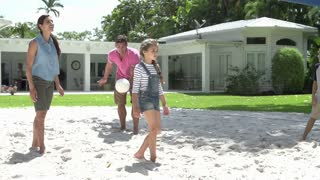 Slow Motion Sequence Of Family Playing Volleyball In Garden
