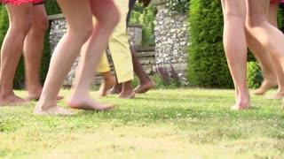 Slow Motion Sequence Of Feet Having Fun In Garden