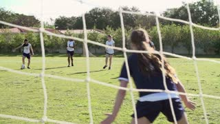Slow Motion Sequence Of Female High School Soccer Team Match