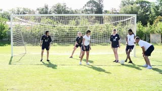 Slow Motion Sequence Of Female School Soccer Team Training