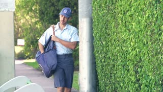 Slow Motion Sequence Of Mail Man Delivering Letters To Woman