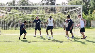 Slow Motion Sequence Of Male School Soccer Team Training