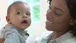 Slow Motion Sequence Of Mother Playing With Baby Son At Home