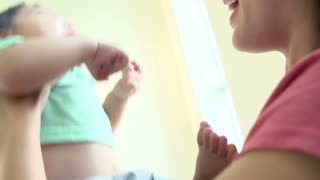 Slow Motion Sequence Of Mother Playing With Son At Home