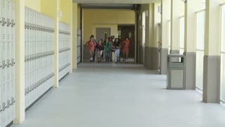 Slow Motion Sequence Of School Students Running In Hallway