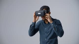 Slow Motion Sequence Of Video Game Designer With VR Headset