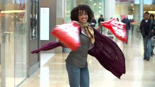 Slow Motion Sequence Of Woman Spinning Around With Bags