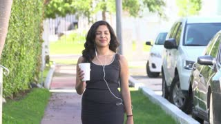 Slow Motion Sequence Of Woman Walking Along Street To Work