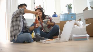 Slow Motion Shot Of Couple Celebrating Moving Into New Home