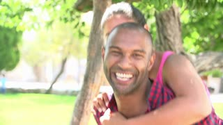 Slow Motion Shot Of Couple Having Fun In Park Together