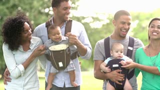 Slow Motion Shot Of Families With Baby Carriers In Park