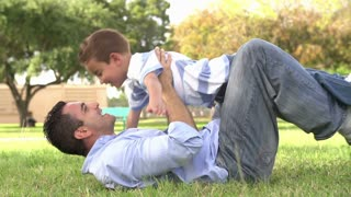 Slow Motion Shot Of Father Playing With Son In Park