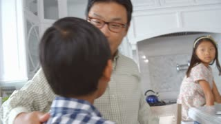 Slow Motion Shot Of Father Saying Goodbye To Family