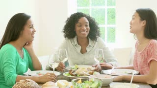 Slow Motion Shot Of Female Friends Enjoying Meal At Home