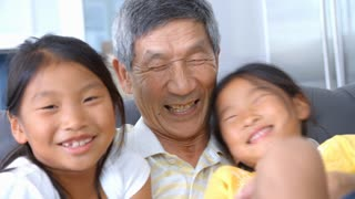 Slow Motion Shot Of Grandfather And Granddaughters Laughing