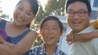 Slow Motion Shot Of Happy Family Group Outdoors