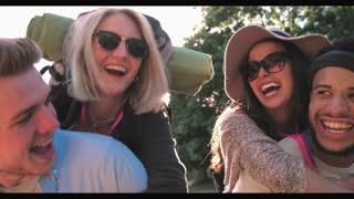 Slow Motion Shot Of Men Giving Women Piggybacks Outdoors