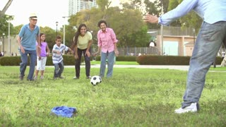 Slow Motion Shot Of Multi Generation Family Playing Soccer