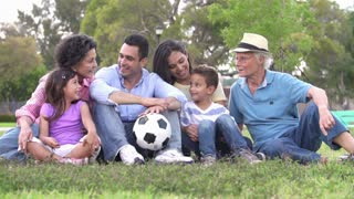 Slow Motion Shot Of Multi Generation Family With Soccer Ball
