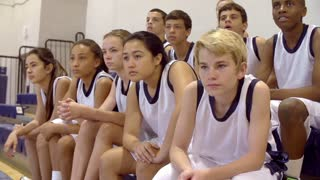 Slow Motion Shot Of Spectators At School Basketball Match