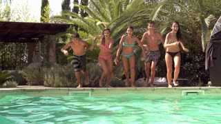 Slow Motion Shot Of Teenagers Jumping Into Swimming Pool