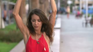 Slow Motion Shot Of Woman Dancing Along Street